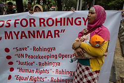 August 28, 2017 - Jakarta, Indonesia - Rohingya and Bangladeshi people protest in front of the United Nations High Commissioner for Refugees (UNHCR) office in Jakarta, Indonesia, urging Myanmar's government to stop the violence against the Rohingya people. The death toll from widespread attacks staged by Rohingya insurgents on Friday has climbed to 96, including nearly 80 insurgents and 12 members of the security forces. (Credit Image: © Afriadi Hikmal via ZUMA Wire)