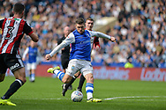 Sheffield Wednesday forward Gary Hooper (14)  with a shot at goal during the EFL Sky Bet Championship match between Sheffield Wednesday and Sheffield Utd at Hillsborough, Sheffield, England on 24 September 2017. Photo by Adam Rivers.
