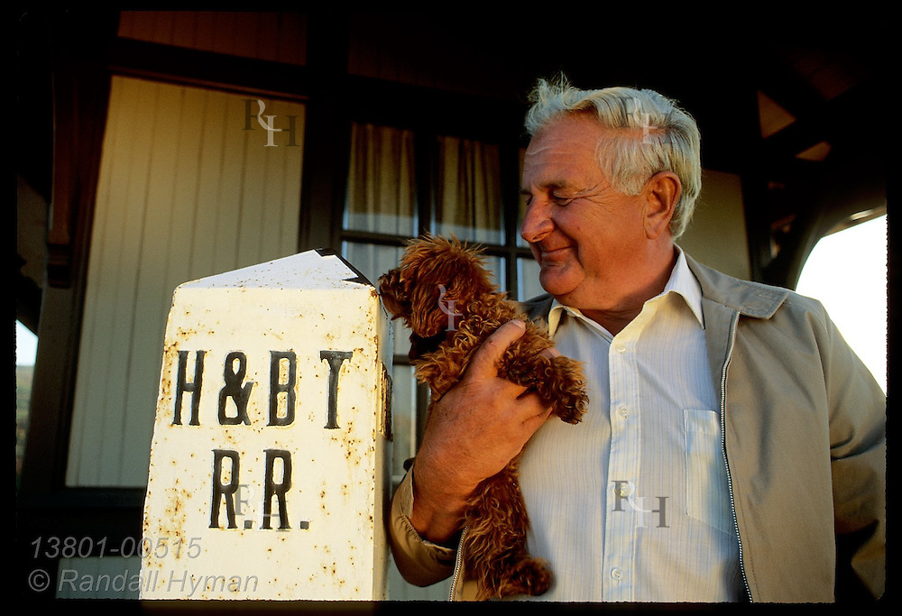 Chuck Hazlett & his dog by division marker at Harrisburg depot he moved to his Hollidaysburg home. Pennsylvania