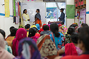 Garment workers playing out a roleplay at a cafe meeting organised and hosted by Awaj Foundation, Dhaka, Bangladesh.<br /> <br /> Awaj Foundation was founded by Nazma Akter in 2003 to support and empower garment workers to negotiate safer and fairer working conditions in factories.
