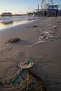 Trash washed up on beach, Santa Monica, California, USA