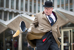 © Licensed to London News Pictures. 05/03/2019. London, UK. Poulterer Benjamin Browning drops his pancake as he takes part in an inter-Livery Company pancake race in Guildhall Yard in The City of London. Participants from the Poulters, the Fruiterers, the Cutlers, Mansion House, Guildhall and Old Bailey are raising money for The Lord Mayor's Charity. Photo credit: Peter Macdiarmid/LNP