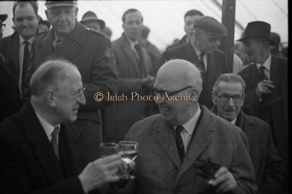 15/04/1966<br /> 04/15/1966<br /> 15 April 1966<br /> Unveiling of Plaque at Boland's Mills. President Eamon de Valera unveils a plaque to commemorate the 1916 Rising at Bolands Mills, where he was Commandant during the insurrection. Picture shows Captain E.J. Hitzen, who arrested President De Valera at Bolands Mills in 1916, toasting the President when they met after 50 years at the unveiling.