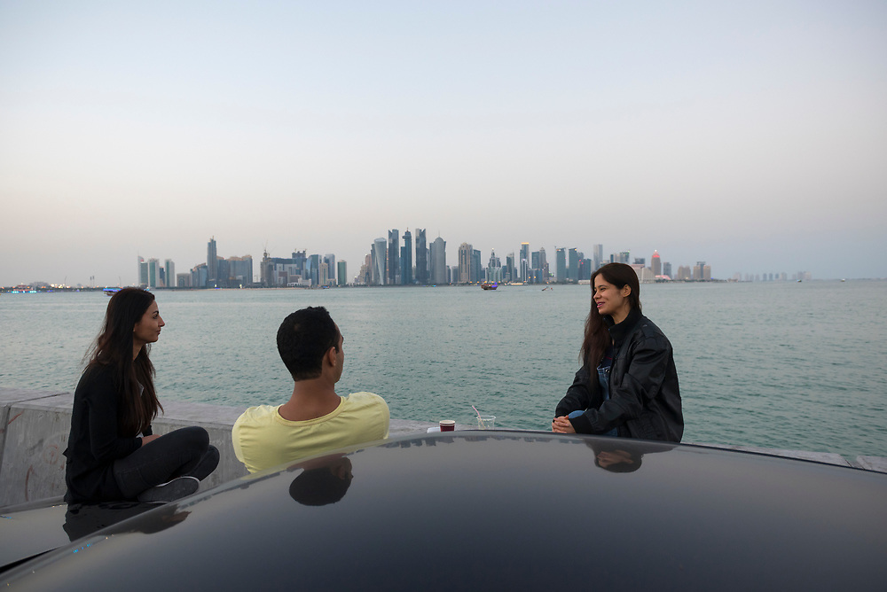 Three people from India employeed as flight attendants, or cabin crew, on Qatar Airways enjoy some time off by the bay in Doha, Qatar (January 2017)