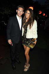 Property developer NICK CANDY and  YAEL TORM-HIBLER at the annual Serpentine Gallery Summer Party in Kensington Gardens, London on 9th September 2008.