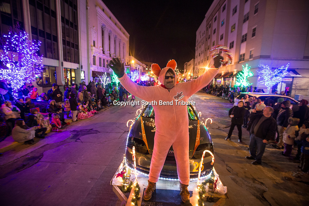 Barry Urban dressed in Ralphie's pink bunny pajamas from the movie, A Christmas Story. Hundreds of people lined Michigan Street for the first light parade on Friday, Dec. 8, 2017, in downtown South Bend. Tribune Photo/SANTIAGO FLORES
