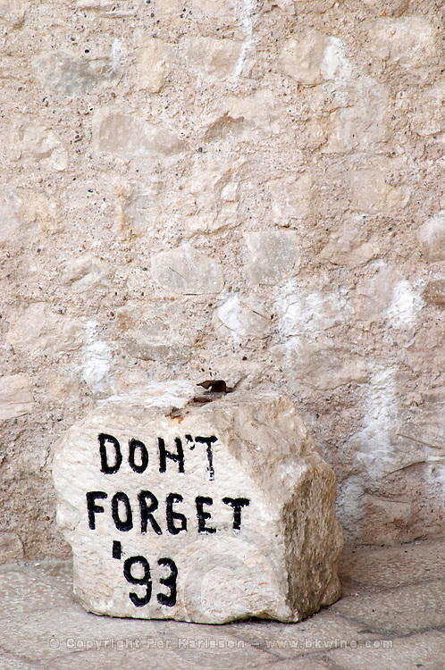 A rock inscribed with Don't Forget '93 referring to the war on the Onescukova street. Historic town of Mostar. Federation Bosne i Hercegovine. Bosnia Herzegovina, Europe.