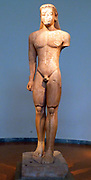 Torso of a kouros.  Island marble.  Found in Sounion.  The colossal statue was votive and originally stood before the Temple of Poseidon, along with the kouros.  About 600 BC