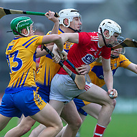 Cork's David Griffin is held back by the Clare defence