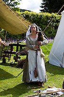 lady in period dress playing the Scottish small pipes