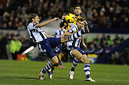 Hull's Danny Graham © is squeezed out by West Brom's Jonas Olsson (l) and Gareth McAuley ®. Barclays Premier league, West Bromwich Albion v Hull city at the Hawthorns in West Bromwich, England on Saturday 21st Dec 2013. pic by Andrew Orchard, Andrew Orchard sports photography.