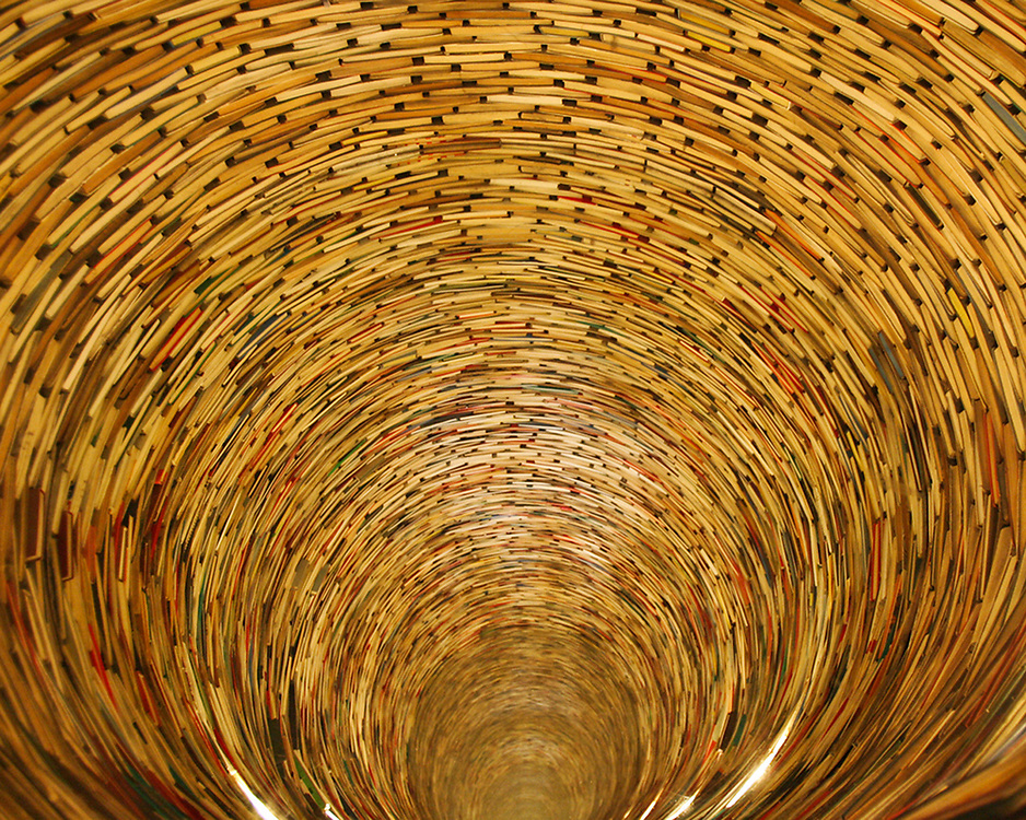 View of books arranged as a funnel