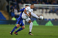 Jay-Roy Grot of Leeds Utd ® holds off Sean Morrison of Cardiff city (l). EFL Skybet championship match, Cardiff city v Leeds Utd at the Cardiff city stadium in Cardiff, South Wales on Tuesday 26th September 2017.<br /> pic by Andrew Orchard, Andrew Orchard sports photography.