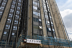 © Licensed to London News Pictures. 25/07/2018. LONDON, UK.  London, UK.  25 July 2018.  Scaffolding covers part of Taplow tower block after cladding was fully removed earlier this year, on the Chalcots Estate in Camden.  Work continues to remedy the problem of flammable cladding and additional fire hazard issues following Camden council's requirement on 23 June 2017 for residents to temporarily vacate their properties as a safety precaution in response to the Grenfell Tower fire tragedy.  The inquest into the Grenfell Tower fire tragedy is ongoing.  Photo credit: Stephen Chung/LNP