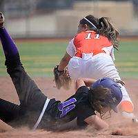040415       Cable Hoover<br /> <br /> Miyamura Patriot Dayna Howard (14) dives back to first base behind Aztec Tiger Jocelyn Ulrich (11) after a pop fly was caught in centerfield Saturday at Ford Canyon Park in Gallup.