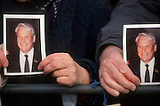 Moscow, Russia, 28/03/93..President Boris Yeltsin addresses pro-democracy demonstrators who have marched to the Kremlin in support of his struggle with the Communist dominated Russian Parliament: two women hold portraits of the Russian President.