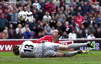 Photo: Greig Cowie<br />Middlesbrough v Arsenal. Barclaycard Premiership 19/04/2003<br />The ball pops up as Stuart Taylor blocks Malcolm Christies path to goal