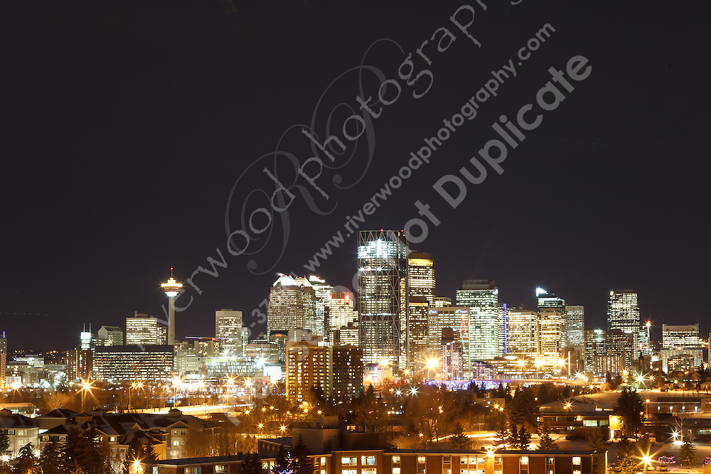 Landscape image of the Calgary city skyline as seen from Scotsman's Hill in North East Calgary.<br /> <br /> ©2011, Sean Phillips<br /> http://www.RiverwoodPhotography.com