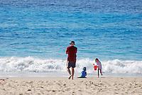 Man, children, beach, sea, Mollymook, New South Wales, Australia, 201003254881..© Victor Patterson, 54 Dorchester Park, Belfast, N Ireland. Tel: +44 2890661296; Mobile: +44 7802 353836; Emails: victorpatterson@me.com & victorpatterson@gmail.com; www.victorpatterson.com