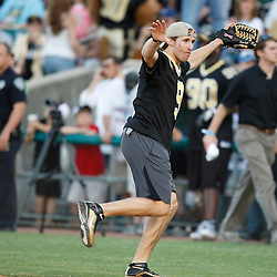 Apr 28, 2010; Metairie, LA, USA; Drew Brees (9) runs off the field during the Heath Evans Foundation charity softball featuring teammates of the Super Bowl XLIV Champion New Orleans Saints at Zephyrs Field.  Mandatory Credit: Derick E. Hingle-US-PRESSWIRE.