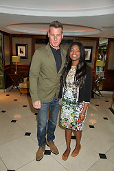 """TIM VINCENT and CHANEL WATSON at a party to celebrate the publication of """"Lady In Waiting: The Wristband Diaries"""" By Lady Victoria Hervey held at The Goring Hotel, Beeston Place, London on 9th May 2016."""