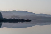 Calm waters in Rocky Pass, early morning fog clearing.