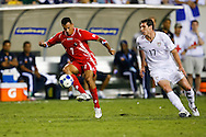 July 18 2009: Blas Perez of Panama moves the ball ahead of Kenny Copper of the USA during the game between USA and Panama. The United States defeated Panama 2-1 in added extra time in a CONCACAF Gold Cup quarter-final match at Lincoln Financial Field in Philadelphia, Pennsylvania.