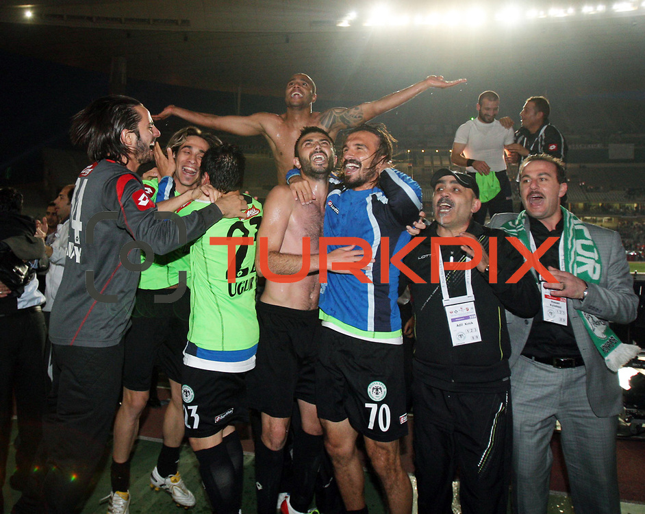 Konyaspor's players Yusuf KURTULUS (C) celebrates victory during their Turkish soccer Play Off final match Altayspor between Konyaspor at Ataturk Olympic Stadium in Istanbul Turkey on Sunday, 23 May 2010. Photo by TURKPIX