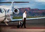Image of executive at the airport exiting a citation jet at Colorado City Muncipal Airport in Arizona.
