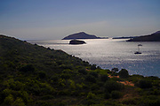 The beach and Mediterranean Sea at sunset, Cape Sounion, Attica, Greece