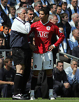 Photo: Paul Thomas.<br /> Manchester City v Manchester United. The Barclays Premiership. 05/05/2007.<br /> <br /> Cristiano Ronaldo (R) of Utd has words to say to the fourth official after coming off to get treatment for a stomp by City's Michael Ball.