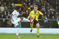 Burton Albion midfielder Jake Hesketh (8) and Coventry City defender Junior Brown (12) during the EFL Sky Bet League 1 match between Burton Albion and Coventry City at the Pirelli Stadium, Burton upon Trent, England on 17 November 2018.