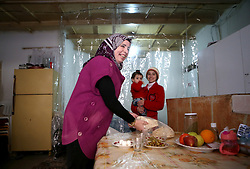 Syrian refugee Hanin Bathish Mtaweh, 13, right, with her mother Ibtissam, 43, and two-year old sister Amar in the basement of a former ski chalet block where they live in Mount Lebanon, just north of the Lebanese capital, after the family fled Syria five years ago.
