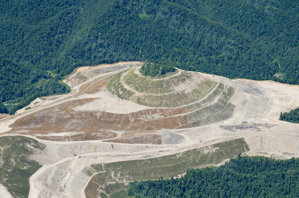 A lone cemetery is now and island in the sky. Many individual graves in West Virginia have been pushed down the mountain along with the overburden. The cemetery now sits alone on a knoll amidst the destruction of open mines.
