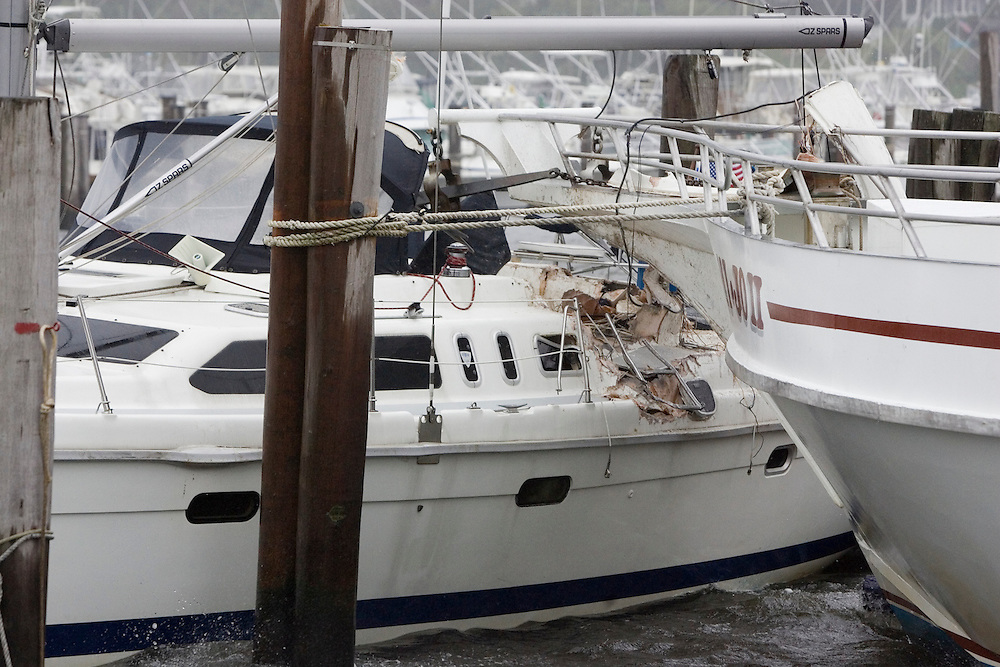 (PPAGE1) Atlantic Highlands 9/2/2006   A sailboat that broke from it's mooring in the Atlantic Highlands Municipal Harbor smashes into the pulpit of the Mi-Jo fishing boat during the storm.  Michael J. Treola Staff Photographer.....MJT