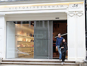 Victoria Beckham new store due to open today in London's Mayfair.<br /> <br /> photo shows: The store's minimalist shop front was unveiled this morning as workers put the finishing touches to the store ahead of its opening later today<br /> ©Exclusivepix