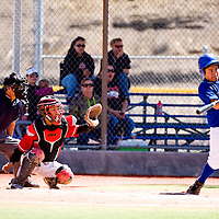 032913       Brian Leddy<br /> Laguna-Acoma Hawk Karl Reid (10) connects at the plate during Friday's tournament game against Hatch Valley.