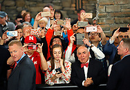Berkshire Hathaway shareholders shoot pictures of CEO Warren Buffett on the Berkshire Hathaway annual meeting weekend in Omaha, Nebraska, U.S. May 7, 2017. REUTERS/Rick Wilking