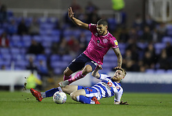 Queens Park Rangers's Nahki Wells (left) is tackled by Reading's Josh Sims during the Sky Bet Championship match between Reading and Queens Park Rangers.