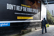 A Londoner walks past a UK government NHS National Health Service billboard - an advert that urges the public to help stop spreading the virus during the third lockdown of the Coronavirus pandemic, on 4th February 2021, in south London, England.