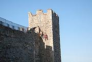 Stonemasons doing maintenance repairs to the stone walls of Framlingham castle, Suffolk, England