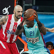 Olympiacos's Pero Antic (L) and FC Barcelona Regal's Boniface Ndong (R) during their Euroleague Final Four semifinal Game 2 basketball match Olympiacos's between FC Barcelona Regal at the Sinan Erdem Arena in Istanbul at Turkey on Friday, May, 11, 2012. Photo by TURKPIX