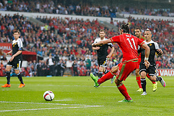 Gareth Bale of Wales (Real Madrid) scores a goal  to make it 1-0 - Photo mandatory by-line: Rogan Thomson/JMP - 07966 386802 - 12/06/2015 - SPORT - FOOTBALL - Cardiff, Wales - Cardiff City Stadium - Wales v Belgium - EURO 2016 Qualifier.