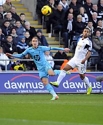 Tottenham Hotspur's Christian Eriksen crosses  - Photo mandatory by-line: Joe Meredith/JMP - Tel: Mobile: 07966 386802 19/01/2014 - SPORT - FOOTBALL - Liberty Stadium - Swansea - Swansea City v Tottenham Hotspur - Barclays Premier League