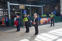 Staff take part in the two minute silence for VE day at the War Memorial at Waverley Station.<br /> Shift Station Manager Bruce Blackie, S/Inspector Chris Jamieson and Station Manager Juliet Donnachie
