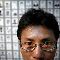 Mae Sot, Thailand 03 October 2007<br /> Aung Kyaw Do, 40 years old, was tortured during his 17 years of prison in Burma. They arrested him for having contacts with Human Rights Organizations. He posses on this picture with photos of other political prisoners, in the Museum of the Association for Assistance to Burmese Political Prisoners (AABPP) in Mae Sot.<br /> Photo: Ezequiel Scagnetti