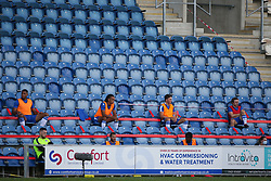 Colchester United subs are socially distanced in the stands - Mandatory by-line: Arron Gent/JMP - 18/06/2020 - FOOTBALL - JobServe Community Stadium - Colchester, England - Colchester United v Exeter City - Sky Bet League Two Play-off 1st Leg