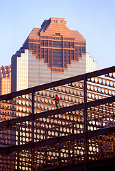 Stock photo of construction worker walking along a beam on an unfinished building in downtown Houston Texas