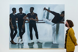 """© Licensed to London News Pictures. 02/12/2020. LONDON, UK. A staff member views """"A Concentration"""", 2018. Preview of """"Lynette Yiadom-Boakye: Fly In League With The Night"""" the first major UK survey exhibition by British artist Lynette Yiadom-Boakye.  Over 70 of her works spanning two decades are on display at Tate Britain.  It is the first new exhibition at Tate since the galleries were re-opened after coronavirus lockdown restrictions were slightly eased by the UK government.  Photo credit: Stephen Chung/LNP"""
