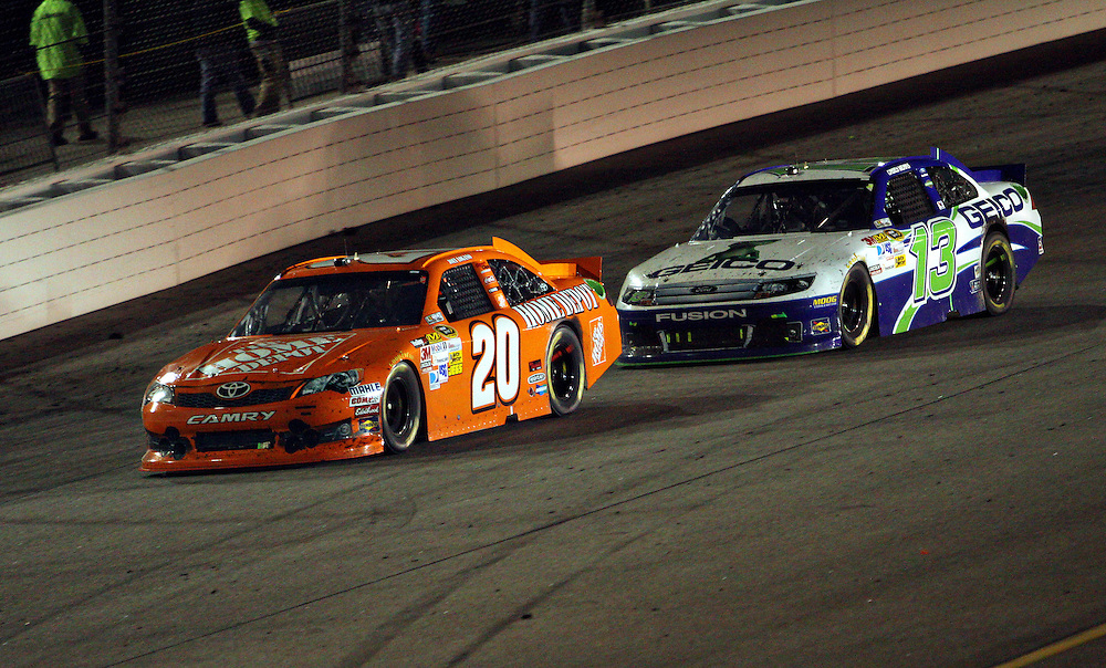 Apr 28, 2012; Richmond, VA, USA; NASCAR Sprint Cup drivers Joey Logano (20) and Casey Mears (13) during the Capital City 400 at Richmond International Raceway. Mandatory Credit: Peter Casey-US PRESSWIRE.